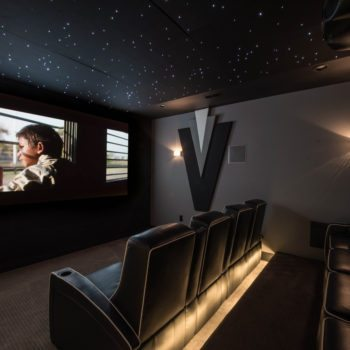 Modern Black and Grey Automated Home Theater